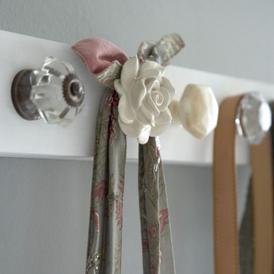 Use antique or vintage door knobs as hooks to hang coats, purses, towels, and more!