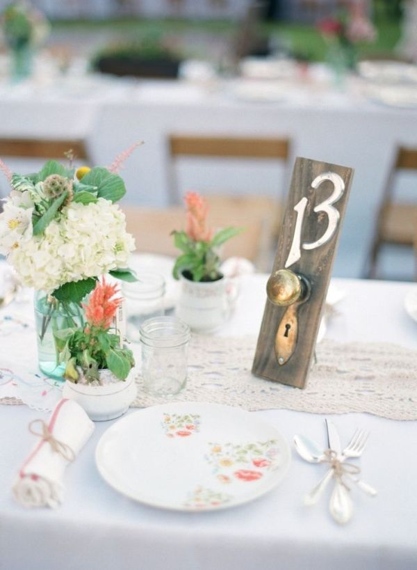If you're planning a rustic or chic wedding, consider using antique or vintage door knobs as table numbers.