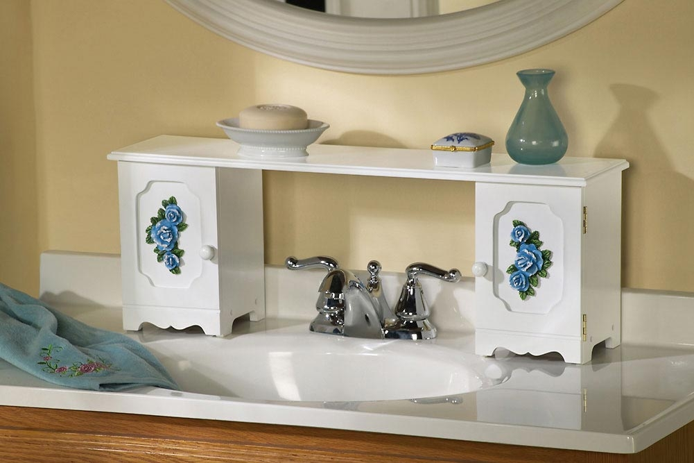 If you have a small sink and counter in your bathroom, expand it by adding an over-the-sink shelf or creating your own movable shelves with spice racks.
