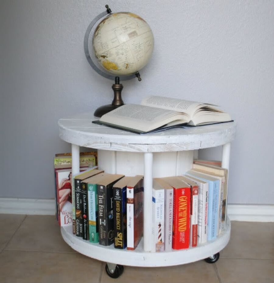 A DIY bookshelf made from a cable spool