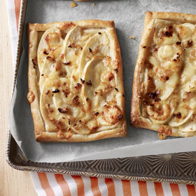 This tart of apple and Gruyere may seem a bit fancy, but it's understated elegance make it equally at home at a dinner party or game day afternoon.