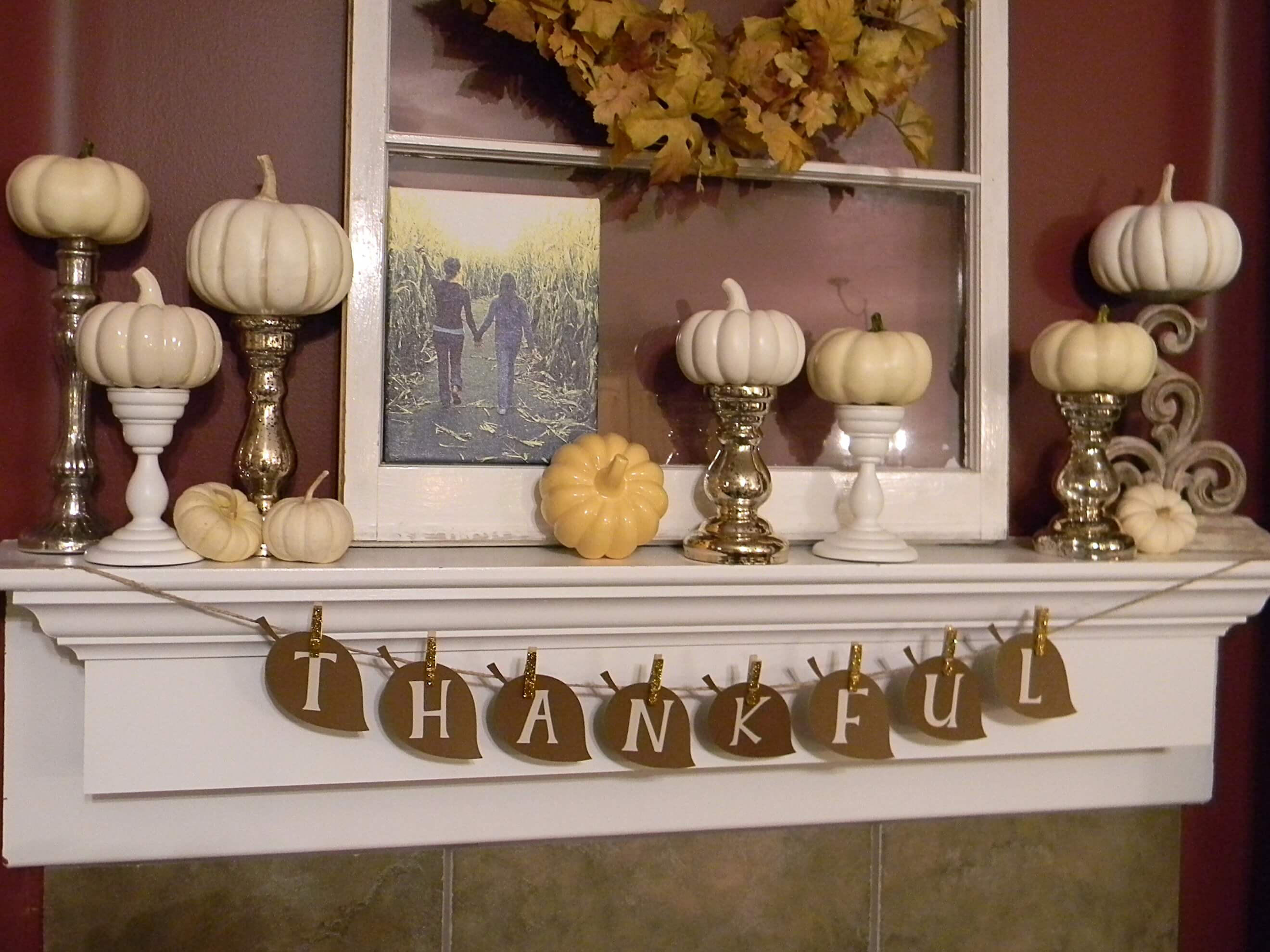 Fireplace mantel decor in the form of white pumpkins everywhere