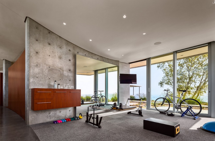 This contemporary style home gym looks great! Image Source: Homes of the Rich