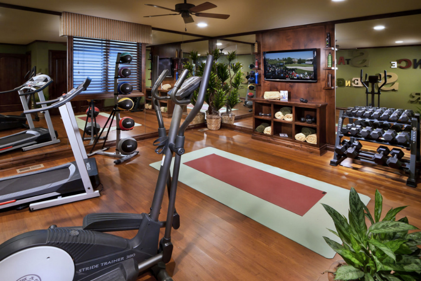This is a traditional decor home gym but the equipment is state-of-art. Image Source: Homes Of The Rich