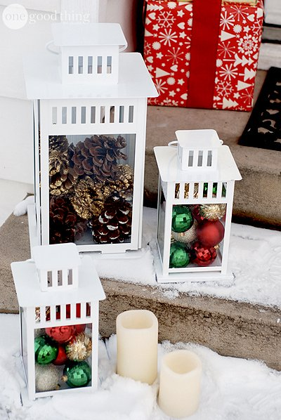 Put ornaments or pinecones in lanterns for quick and easy decorations for your front steps!