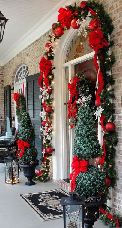 Red and green are the quintessential colors for the holidays, so use them on your front porch to welcome your guests!