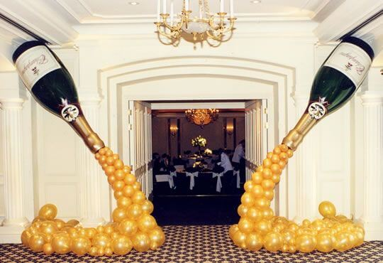 These giant, inflatable champagne bottle balloons are perfect for a New Year's Eve party!