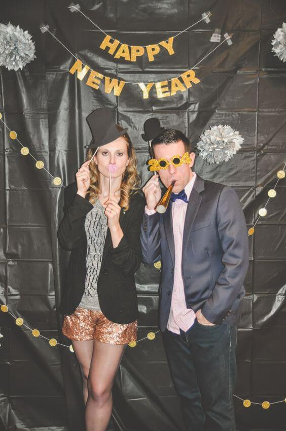 DIY Photo booths are a great addition to any New Year's Eve party!