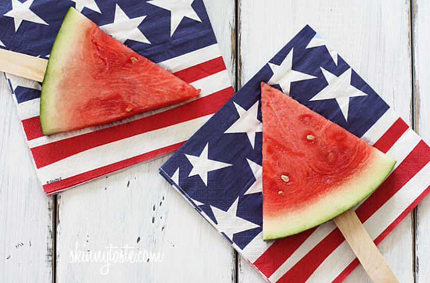Putting watermelon on a stick is a genius way to eat the fruit without getting messy!