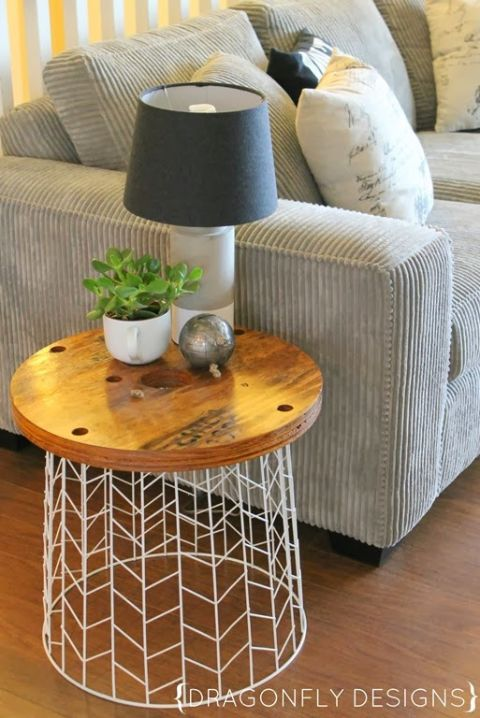 Flip a laundry basket and turn it into this cool table for lamp. Image Source: Good Housekeeping
