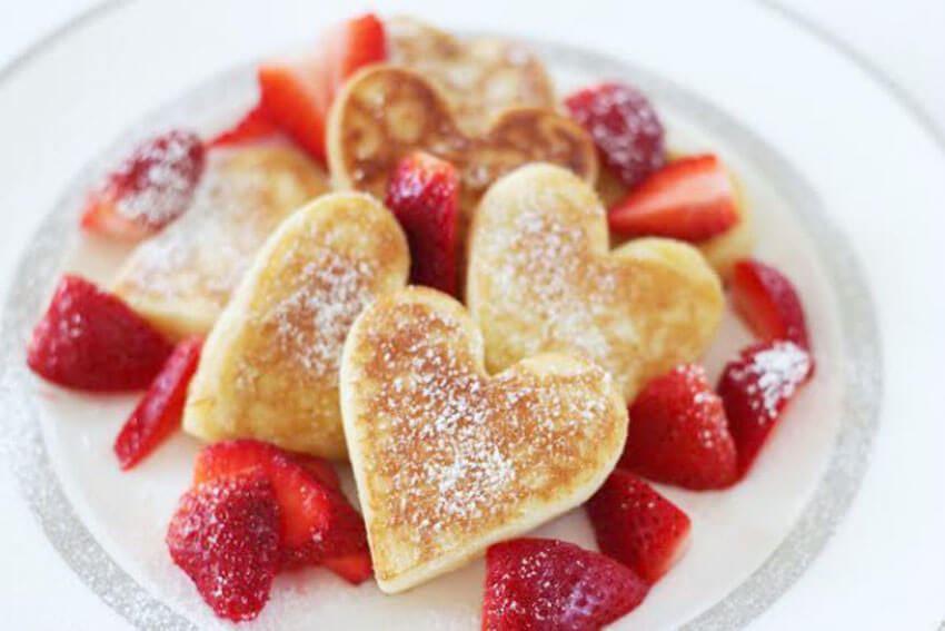 Along with heart-shaped bacon, these heart pancakes make the perfect breakfast!