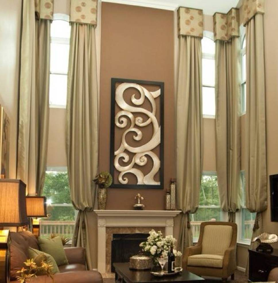 http://www.ultimatechristoph.com/7557-stylish-tall-window-treatments/tall-window-treatments-drapery-and-small-valances-and-brown-walls-and-metal-wall-art-over-mantel/