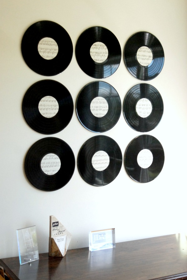 Use old (or fake) vinyl records to create glamorous musical wall art.