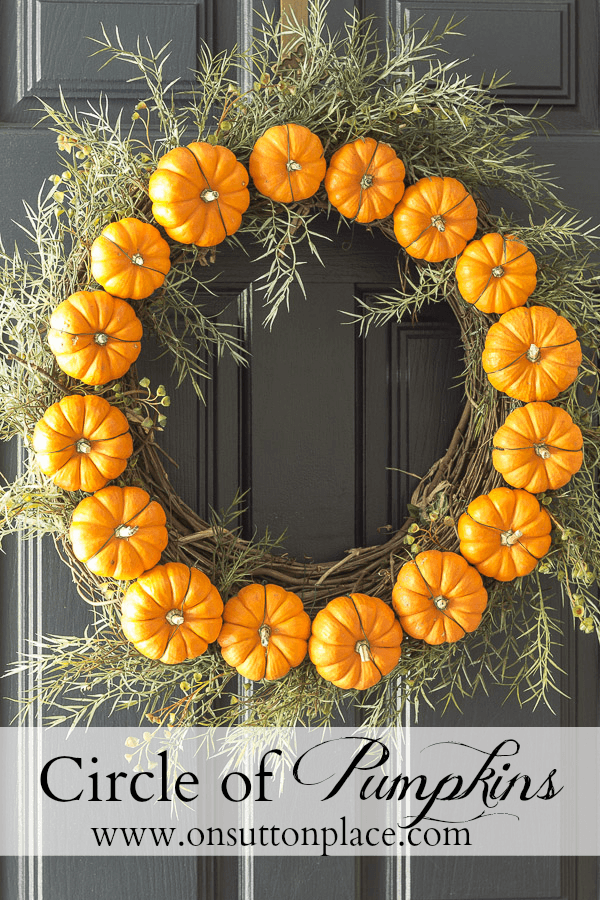 This DIY fall wreath is made from pumpkins!