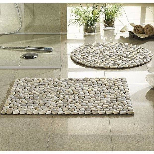 Use smooth river pebbles to create a spa-like bath mat for your bathroom.