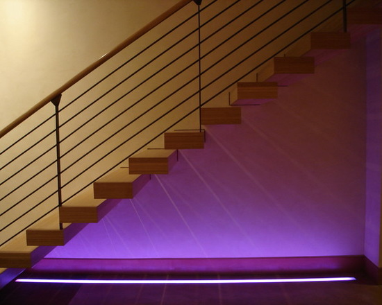 Instead of lighting up each step individually, light up your entire staircase for some beautiful ambient lighting.