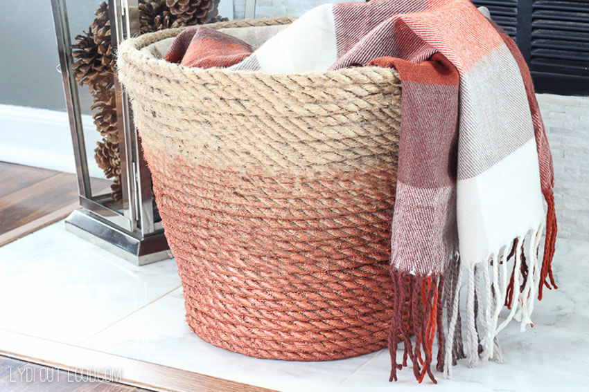 This DIY ombre rope basket is perfect for holding extra blankets!