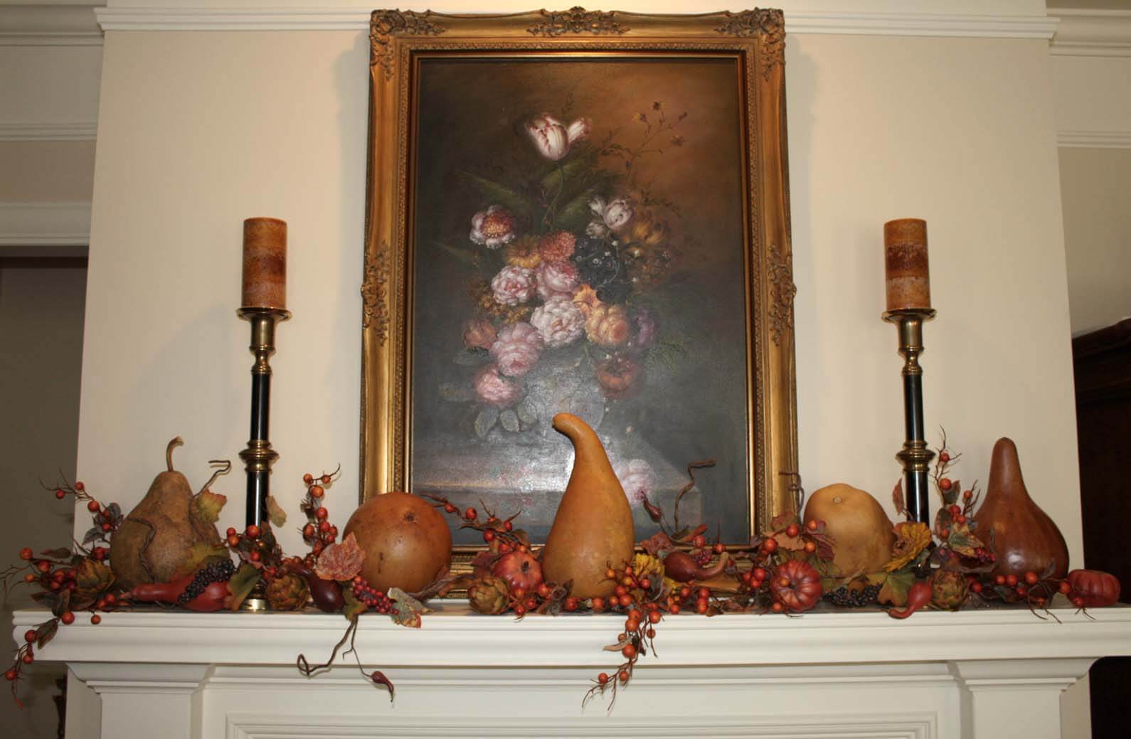 Use gourds as Fall DIY decor on a fireplace mantle in your home's interior.