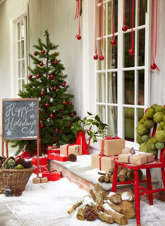 Adding an extra Christmas tree to your front porch will surely welcome in the season!