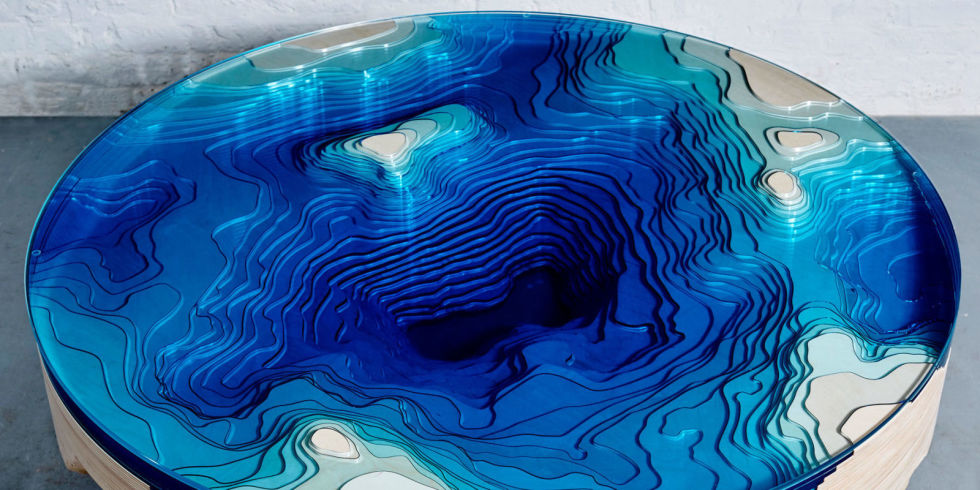 Get a piece of the ocean in your living room with this amazing designer coffee table. Image Source: Elle Decor