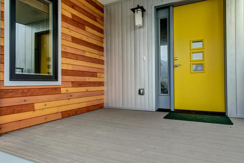Yellow is a cheerful color for a front door.