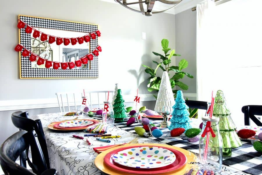 Colorful plates and bright trees will complement the look. Source: Kate Decorates