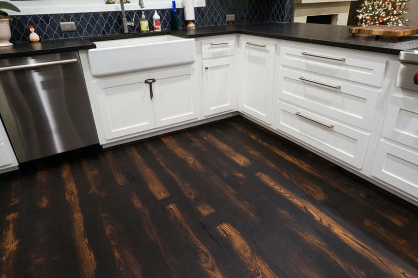 Burned wood flooring is perfect for the kitchen.