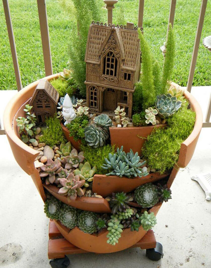Broken pots can be turned into charming fairy gardens!