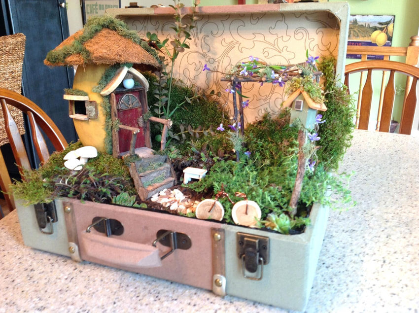 If you have a vintage suitcase lying around, use it to make a fairy garden!