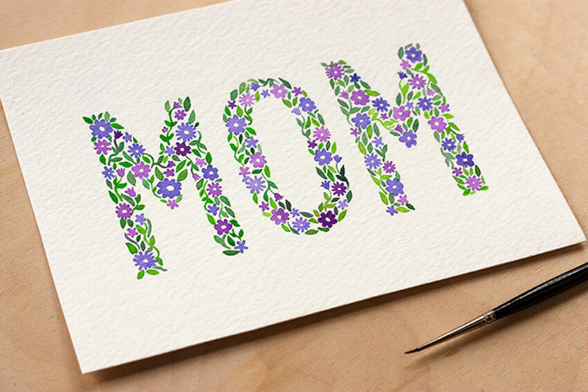 Use watercolors to make your mom a special card.