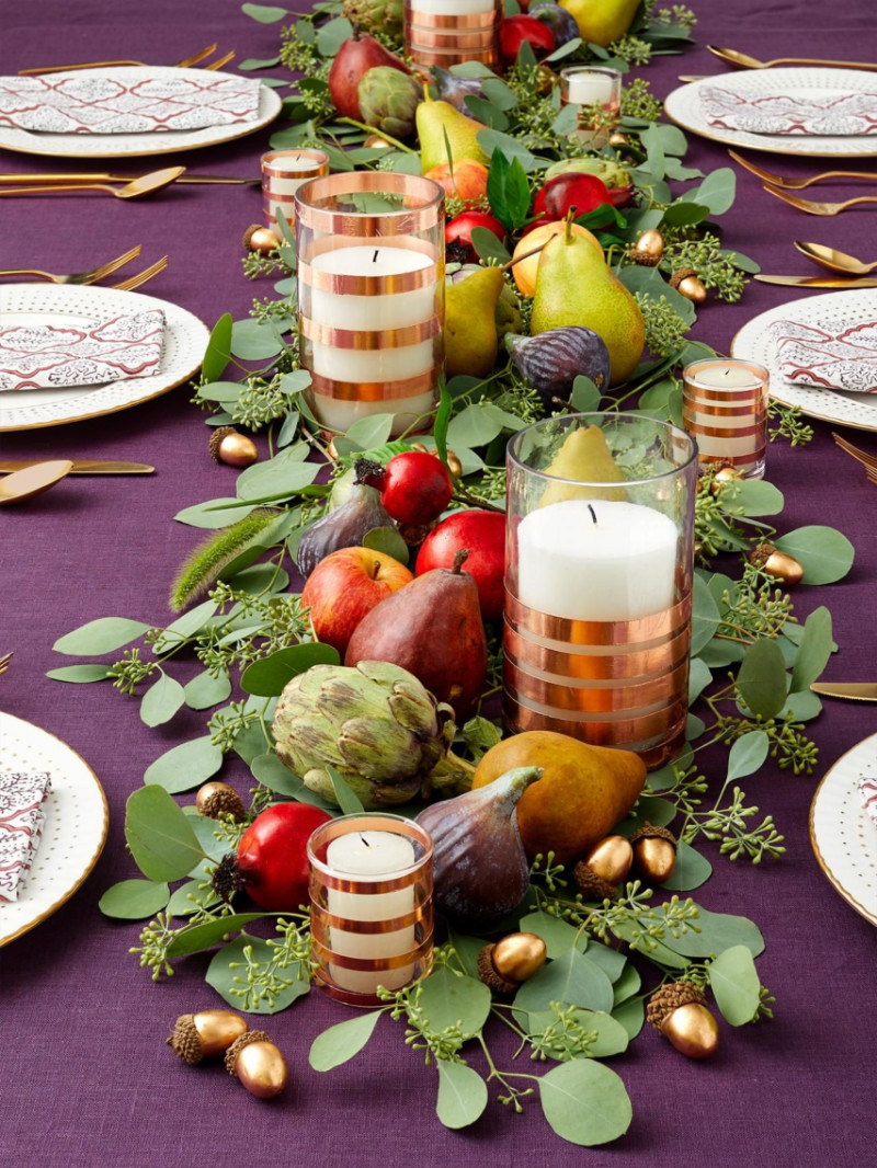 Gather some hours, fruits and greenery to create this centerpiece! Source: HGTV