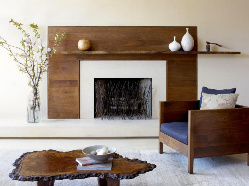 Wood can revamp your fireplace and make it look rustic! Source: Decor Aid