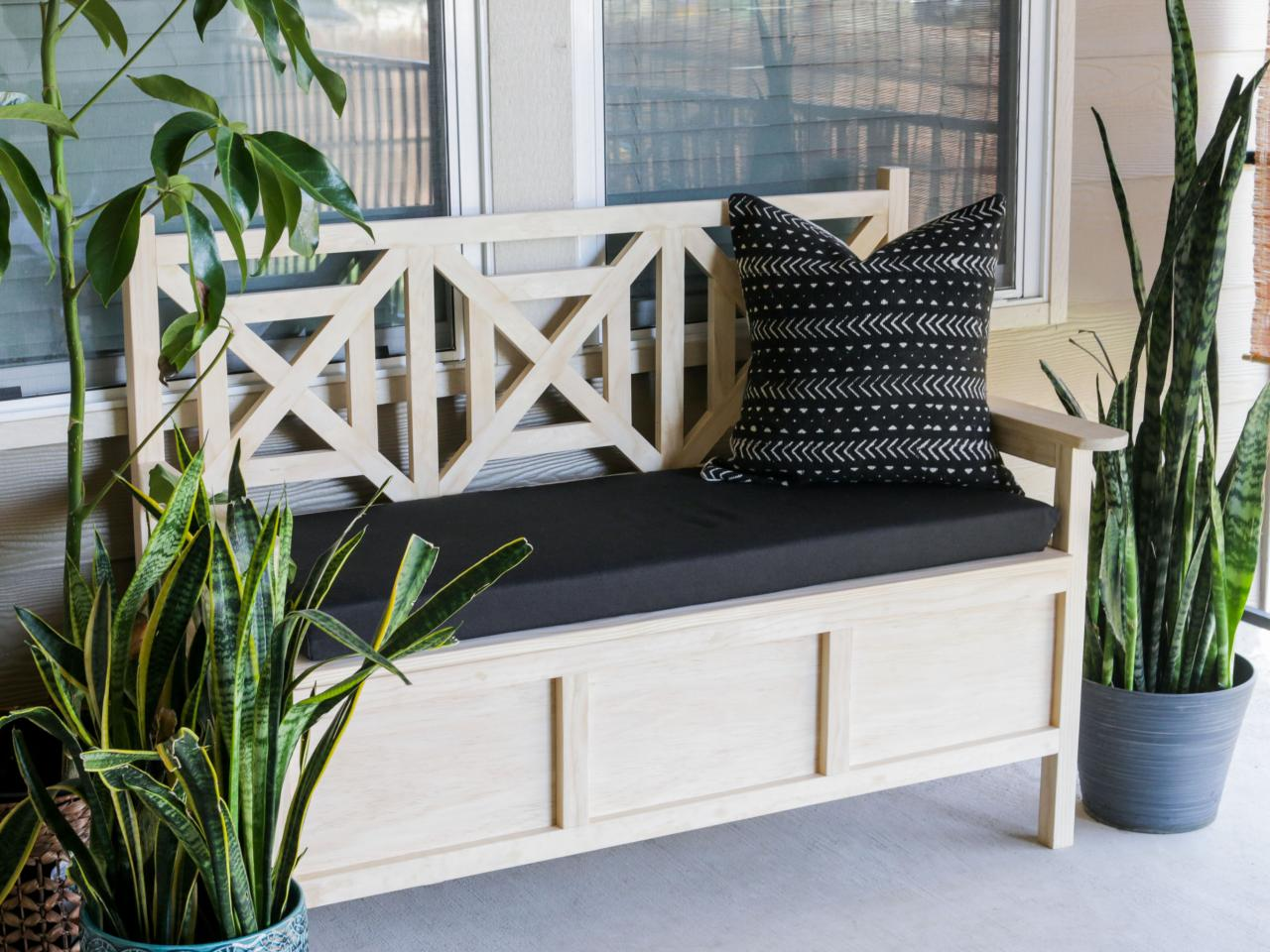 Store extra throw pillows or gardening tools there! Source: HGTV
