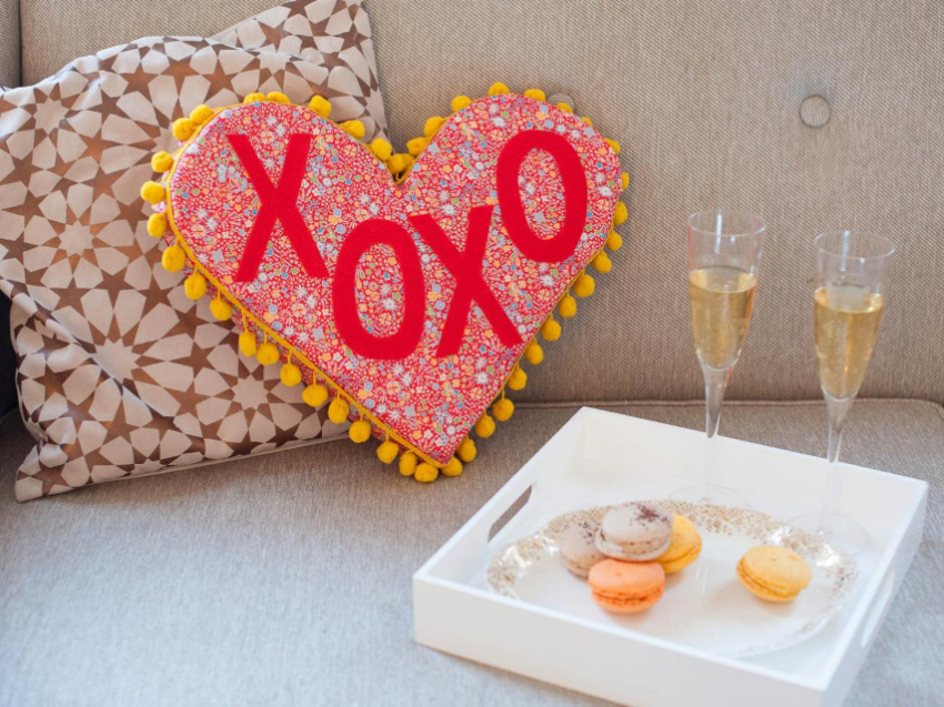Anyone would love to receive a heart-shaped pillow! Source: HGTV